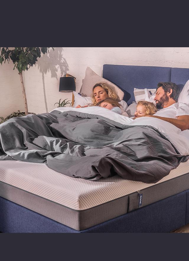 Family sleeping on Emma Mattress