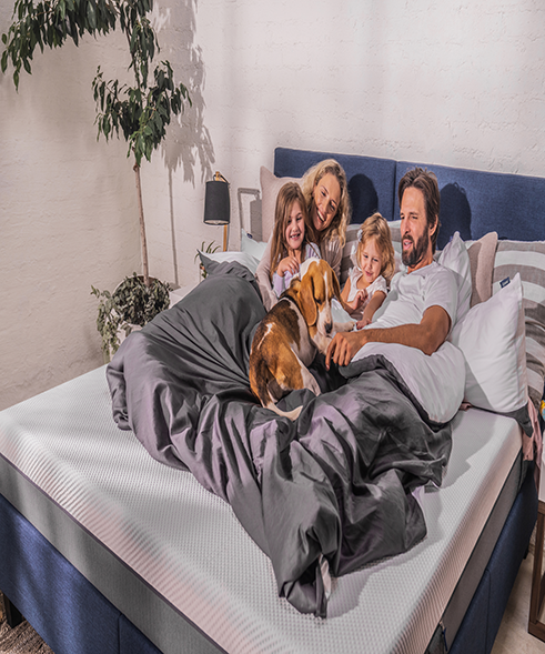 Family sleeping on the Emma Original Mattress