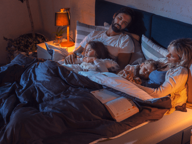 Family sleeping on the Emma Original Mattress